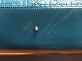 Gouges on handbag exterior