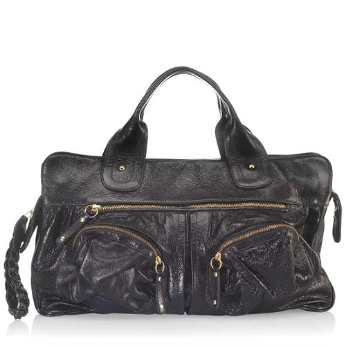 We Love The Ultrasoft Texture Of This Luxe Bulga Handbag Meticulously Crafted Black Cowhide Satchel Is Shapely And Has Plenty Storage Room