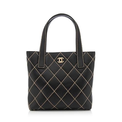 fbeba800d252 Chanel-Calfskin-Surpique-Small-Tote_84366_front_large_0.jpg