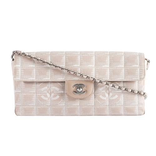 678a2bd69b9ac9 Chanel-Canvas-CC-Logo-Travel -Line-Flap-Shoulder-Handbag_41895_front_large_1.jpg