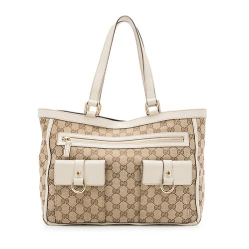 bbf214463fb0ed Gucci-GG-Canvas-Abbey-Pocket-Tote_97982_front_large_0.jpg