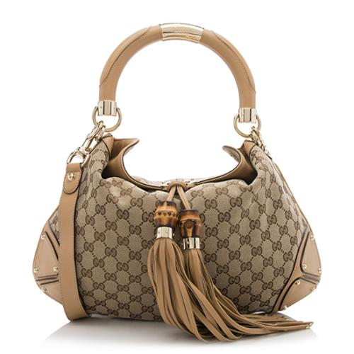 4f3a3724f0b Gucci-GG-Canvas-Indy-Medium-Satchel 90309 front large 0.jpg