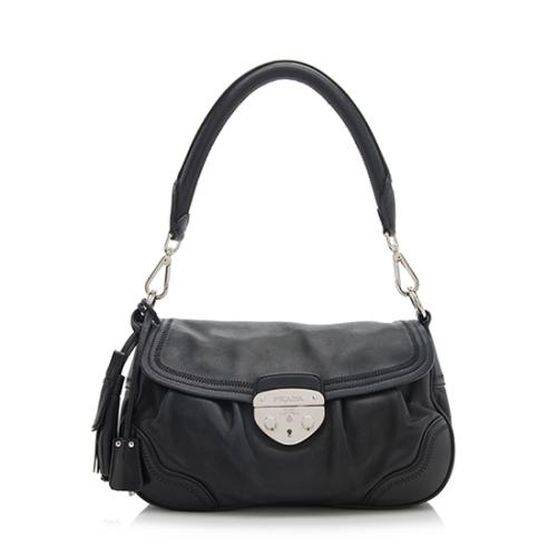 9ea3fb8235f4 Prada-Nappa-Leather-Pushlock-Flap-Tassel -Shoulder-Bag_86049_front_large_0.jpg