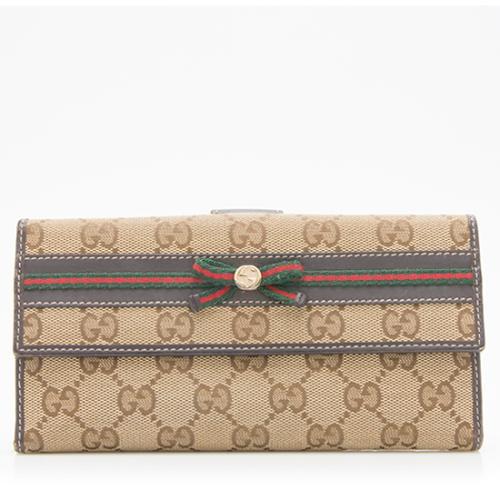 991143e55e27cb Gucci-GG-Canvas-Mayfair-Continental-Wallet_96204_front_large_0.jpg